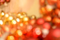 Blurred red and gold christmas baubles background balls Royalty Free Stock Images
