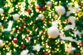 Blurred red, green, and gold bokeh background of Christmas tree. Xmas background. Christmas and Happy New Year holiday background. Royalty Free Stock Photo