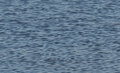 Blurred ripples on water soft focus closeup of background in lake Stock Images