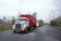 Blurred Semi Truck Convoy In R...