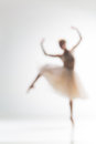 Blurred silhouette of ballerina on white background dancing Royalty Free Stock Photos