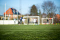Blurred soccer pitch close up of turf with players in the background Royalty Free Stock Photos