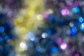 Blurred tinsel defocused decorative christmas as background with bokeh effect Stock Photo
