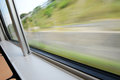 Blurred window view a from a train in motion Royalty Free Stock Photo