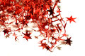 Blurry abstract background of red Christmas garland with red stars on white Royalty Free Stock Photo