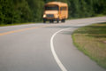Blurry abstract view of school bus driving on  road Royalty Free Stock Photo