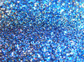 Blurry background of blue, black, golden and red glitter sparkle