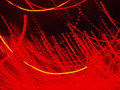 Blurry defocused red night lights on darkness