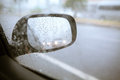Blurry drop of rain on car side mirror on the road with vintage Royalty Free Stock Photo