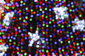 Blurry lights christmas tree with multicolor Stock Images