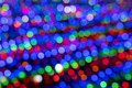 Blurry multicolored garland with glowing lights. Christmas, new year, birthday and wedding concept Royalty Free Stock Photo