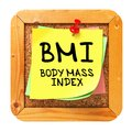 Bmi yellow sticker on bulletin body mass index written cork or message board health concept Royalty Free Stock Images