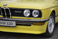 yellow BMW 520 E12 front end Royalty Free Stock Photo