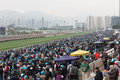 Bmw hong kong derby raceday the is held on march at sha tin racecourse grandstand is packed with racegoers each receives Stock Photo