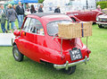 Bmw isetta with picnic basket photo of a bright red on the rear rack showing at whitstable car show on th june photo ideal for Royalty Free Stock Photo