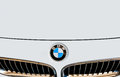 Bmw logo emblem and grille close p of a white front part Royalty Free Stock Image