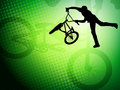 Bmx cyclist on the abstract background stunt Royalty Free Stock Photography