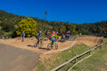 Bmx riders race track pedal full speed over the first jump during the kz province trial heats for nationalss at giba gorge circuit Royalty Free Stock Photos