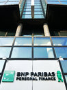 Bnp paribas personal finance logo and name on office building levallois perret france Royalty Free Stock Image