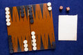 Board game backgammon set to play and a piece of paper Royalty Free Stock Photo