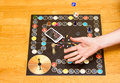 Board game. The hand throws the dice