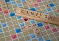 Board game letters spelling out on Stock Image