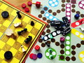 Board games are carelessly strewn across the table Stock Photo