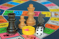 Board games, chess pieces and dice on game board with lot of colors Royalty Free Stock Photo