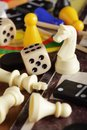 Board games detail of pawns chessmen dominoes and dices Royalty Free Stock Images