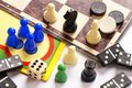 Board games pawns chessmen dominoes and dice Royalty Free Stock Photos