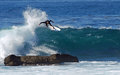 Board surfer riding in a wave at laguna beach ca image shows dangerously close to rocks rock pile below heisler park california Stock Images