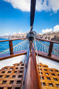 On board view from a traditional ship cruising on Aegean sea next to Santorini island. Royalty Free Stock Photo