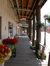 Board walks of taos bright flowers decorate the rustic new mexico Royalty Free Stock Photography