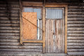 Boarded up windows and old door of a abandoned house Stock Image