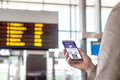 Boarding pass in smartphone. Woman holding phone in airport with mobile ticket on screen. Royalty Free Stock Photo