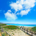 Boardwalk in Capo Testa under a cloudy sky Royalty Free Stock Photo