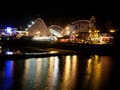Boardwalk at night santa cruz california with the roller coaster and the other attractions illuminated lights reflections on the Stock Photos