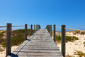 Boardwalk protecting a fragile dune ecosystem deserted elevated wooden and habitat from damage due to pedestrian traffic crossing Royalty Free Stock Image