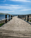 Boardwalk to the beach beautiful and hot summer day take this and go Royalty Free Stock Images