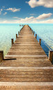 Boardwalk to the horizon turquoise water and blue sky with clouds Royalty Free Stock Images