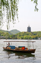 a boat from across before west lake leifeng pagoda Royalty Free Stock Photo