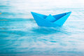 Boat alone in the sea a origami paper Stock Images