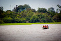 A boat in the amazon river jungle lagoon Royalty Free Stock Photo