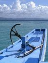Boat with anchor in blue waters palawan travelling transportation on calm to a peaceful resort on one of the islands philippines Royalty Free Stock Image