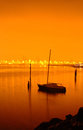 Boat anchored on calm water at night Royalty Free Stock Photo