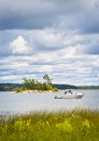 Boat anchored on lake motorboat with dinghy in georgian bay ontario canada Stock Photos