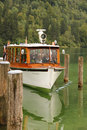Boat approaching the pier at St Bartholoma. Konigssee. Germany