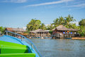 Boat arriving in a traditional indonesian village Royalty Free Stock Photo