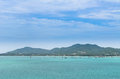 Boat in a bay with green sea and blue sky (at chalong bay, phuke Royalty Free Stock Photo