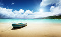 Boat on beach mahe island seychelles Royalty Free Stock Photos